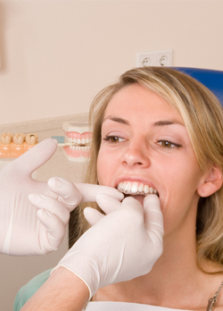 Dentist placing ClearCorrect page