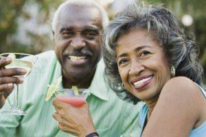 A man and woman enjoying a drink.