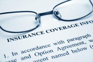 glasses on dental insurance paperwork