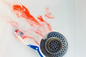 toothbrush blood in sink